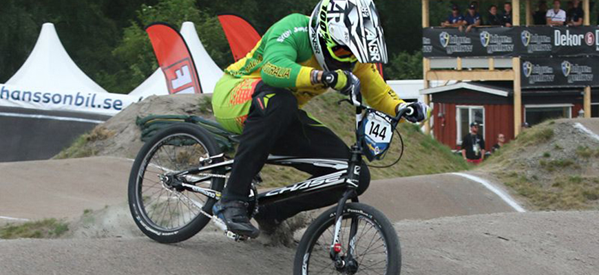 Anthony Dean on a bike going over a jump