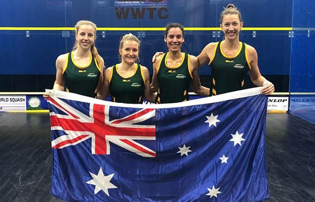 Alex Haydon Hockey standing holding Australian Flag with other athletes